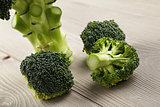 fresh broccoli on wood board