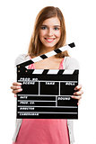 Woman holding clapboard