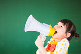 cute child  using a megaphone in a classroom