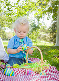 Cute Little Boy Enjoying His Easter Eggs Outside in Park