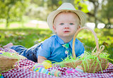 Cute Little Boy Smiles With Easter Eggs Around Him