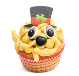 Cupcake with top hat decoration against white background in front of white background