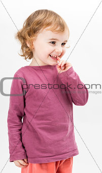 abashed young girl in light grey background