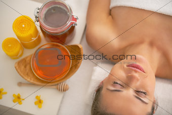 Portrait of young woman relaxing at spa