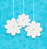 Set Christmas paper snowflakes on blue grunge background