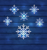 Christmas set variation snowflakes on wooden background