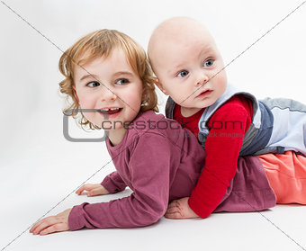 two children playing on floor