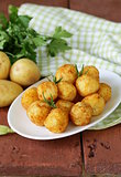 fried potato balls (croquettes) with rosemary