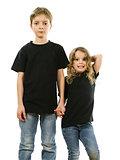 Young children wearing blank black shirts