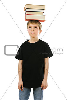 Boy balancing books on his head