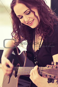 Smiling acoustic guitar player