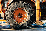Snow chains on tractor tire