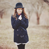 Curly hair spring girl in coat.