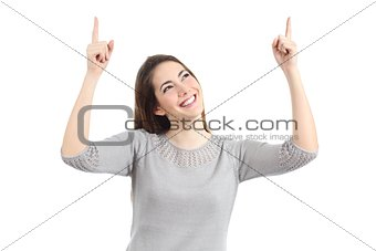 Happy woman pointing up with both hands