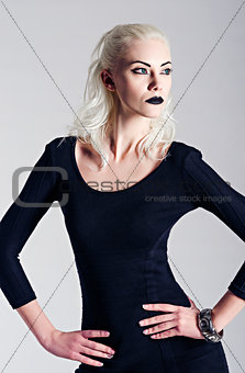 Studio fashion shot: beautiful girl in black dress