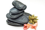 Stack of black stones with fake flowers