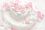 Pink and white delicious luxurious wedding cake with roses