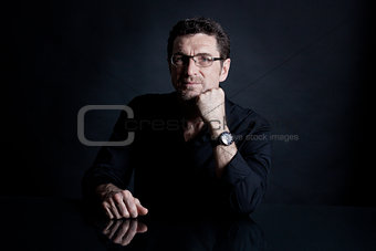 attractive adult man with glasses on black background
