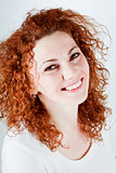 attractive young redhead woman smiling portrait