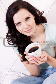 smiling brunette woman drinking black coffee