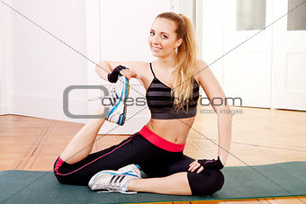 attractive young woman doing workout stretching