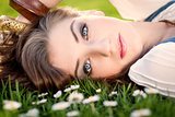 beautiful woman lying in grass in summer