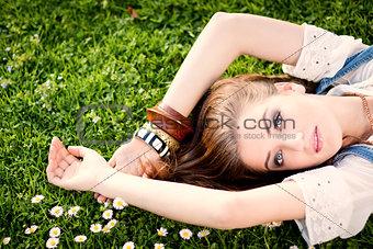 beautiful woman lying in grass in summer