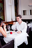 waiter serve fresh espresso for happy couple