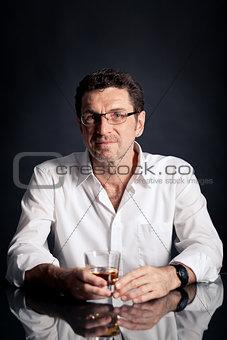 adult man holding an alcoholic drink