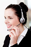 smiling young female call center agent with headset