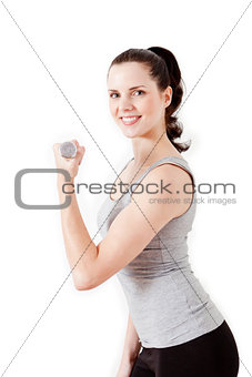 attractive young woman doing fitness dumbbell