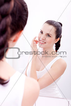 applying cream on face skincare