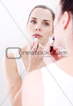 applying cream on face skincare