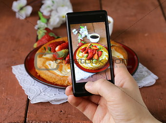 smartphone shot food photo -  vanilla cake with strawberries