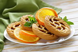 mini dessert tarts with orange on wooden table