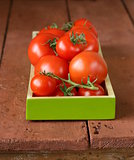 fresh ripe organic tomatoes on a wooden table