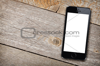 Smart phone on wooden table