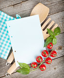 Blank notepad paper for your recipes with tomatoes and basil