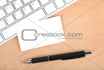 Blank business cards over keyboard on office table