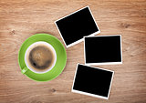 Cup of coffee and three photo frames