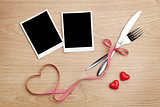 Blank photo frames with heart candy and silverware