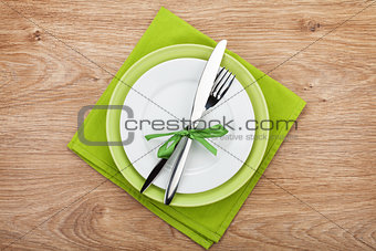 Fork with knife over plates