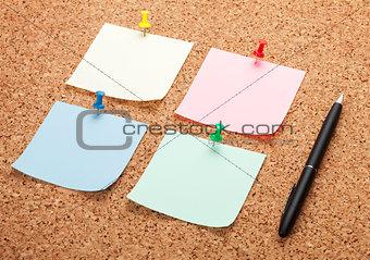 Blank postit notes on cork notice board