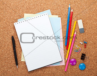 Blank notepad on cork notice board