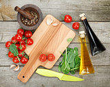 Fresh ingredients for cooking: tomato, salad and spices