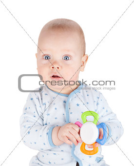 Cute baby boy is holding toy