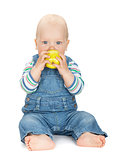 Small baby boy eating an apple
