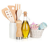 Kitchen utensils in holder and condiments