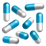 Set of blue and white medical capsules in different positions