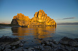 Shaman Rock in the rays of the rising sun. Olkhon Island, Baikal